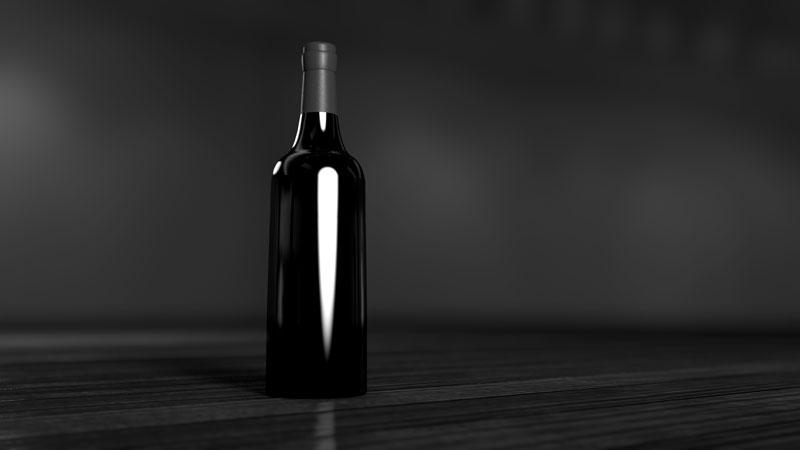 Fotografia productos como esta botella a la perfección con softbox