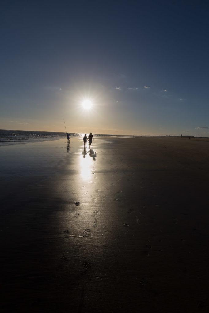 Incluyendo el sol en paisaje de playa